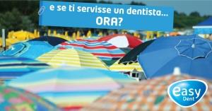 spiaggia affolata di ombrelloni con scritta e se ti servisse un dentista ora?